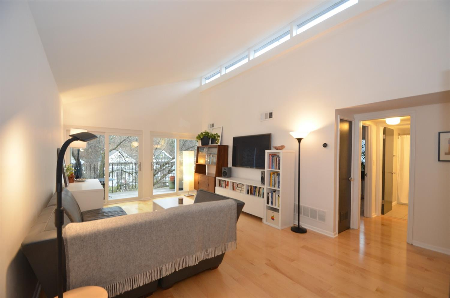 What a 'great room!'  Complete with maple floors, crisp white walls, and new Gilkey windows.