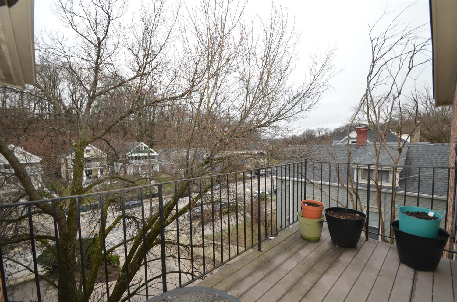 The private balcony overlooks the front (Delta Ave) and is beautiful in all seasons.