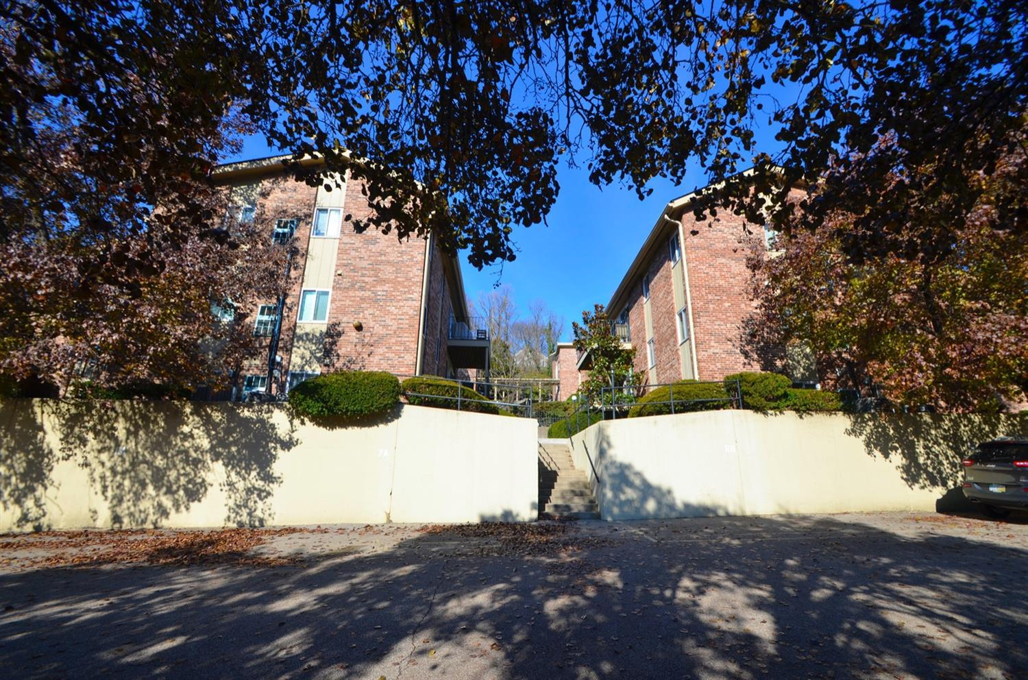 This unit comes with one parking space and it is located right in front of this wall to the left.  Space 8A.  Additional parking is on the street and is plentiful and free - no permit required.  There are also designated guest spots in the parking lot.