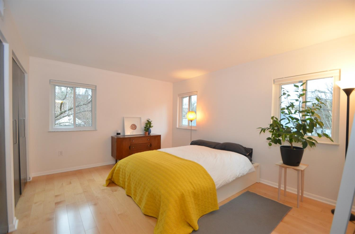Light filled bedroom - with new Gilkey slider windows, maple floor and double closets!