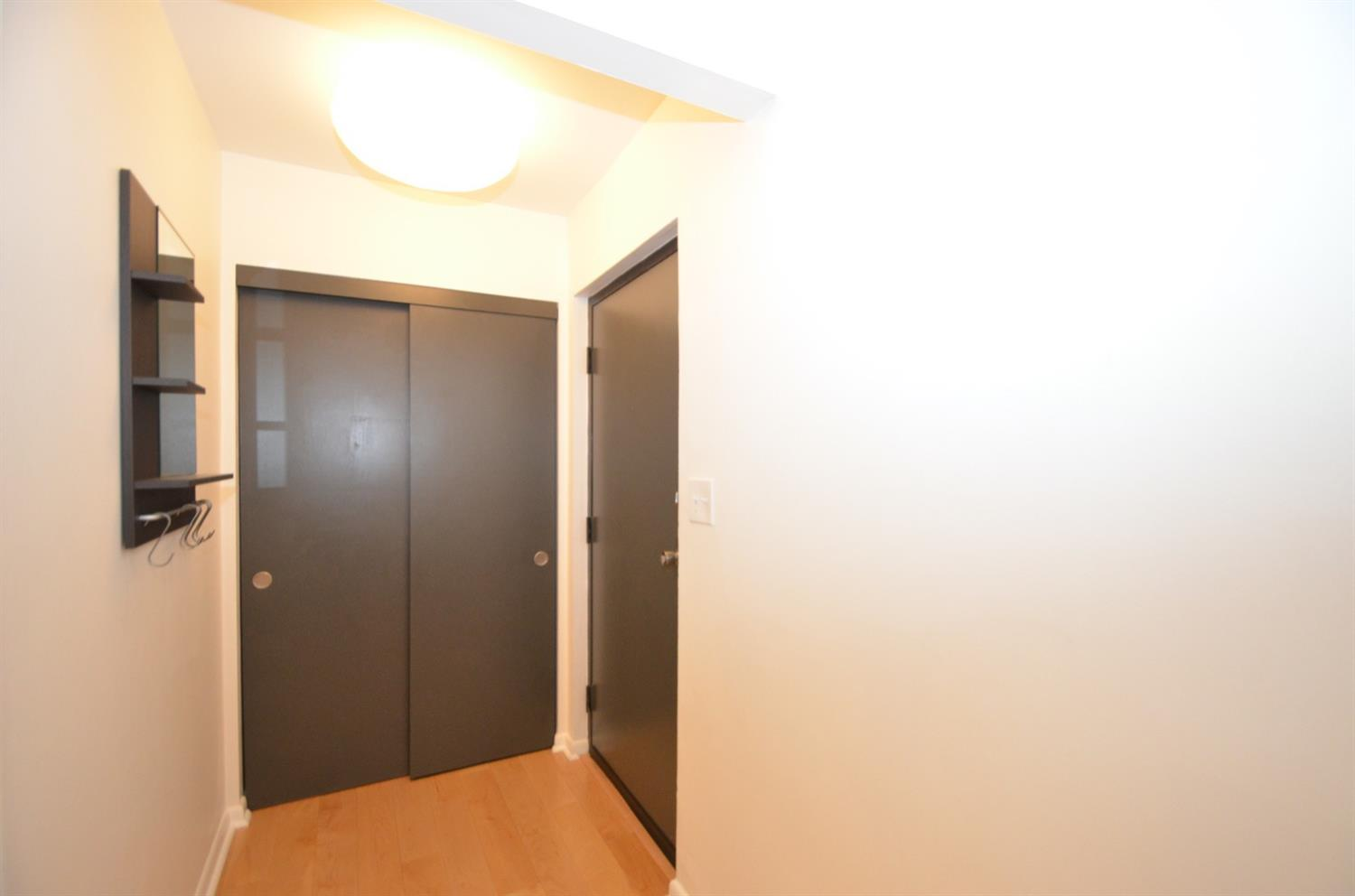 There is no shortage of storage in this small condo!  There are several closets including this entry closet with built ins.