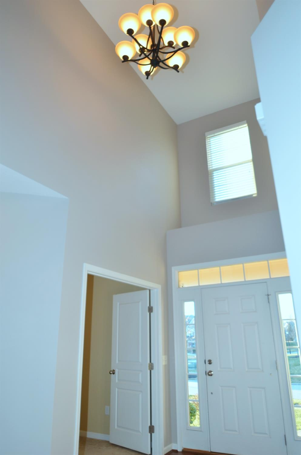 Another view of the soaring double-height entry and double doors to the study.