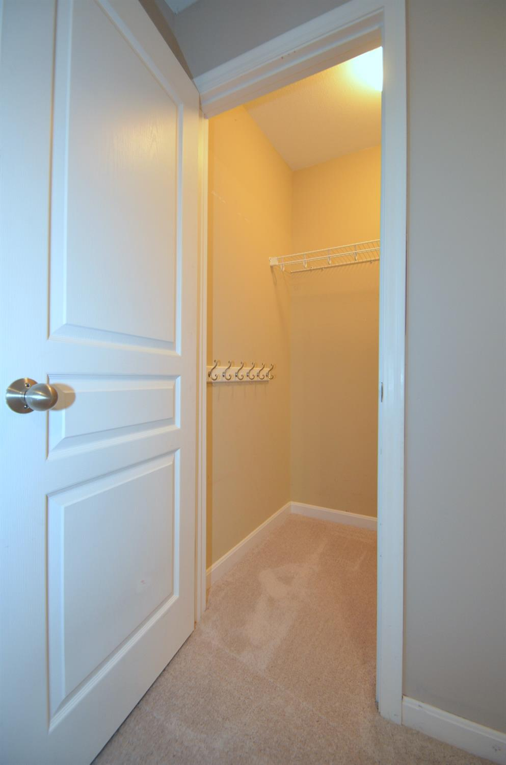 Bedroom 2. View of one of the bedroom walk-in closets.
