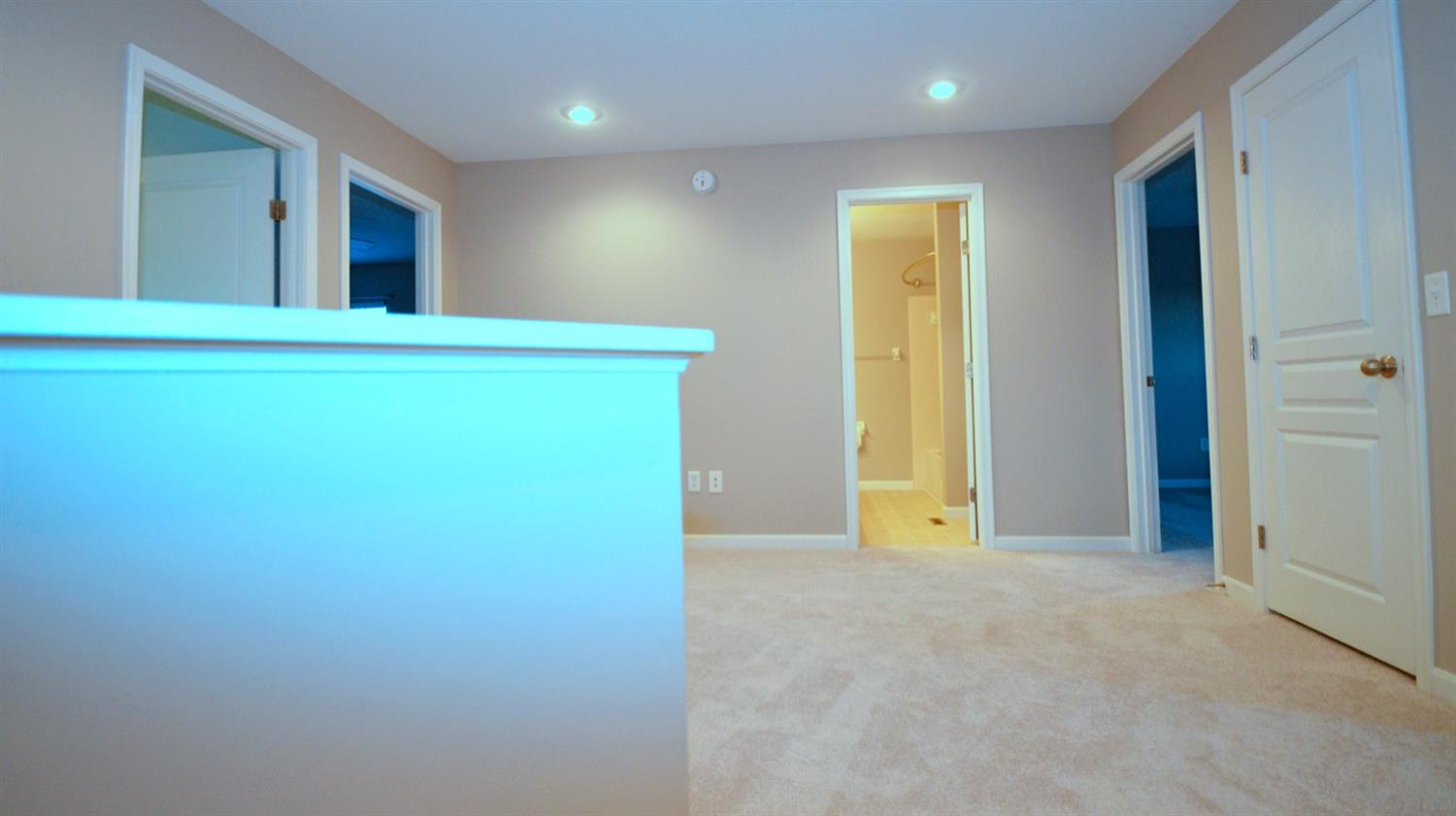 The home's 4 bedrooms, bath and step saving bedroom level laundry surrounding an open bonus hangout or study space.