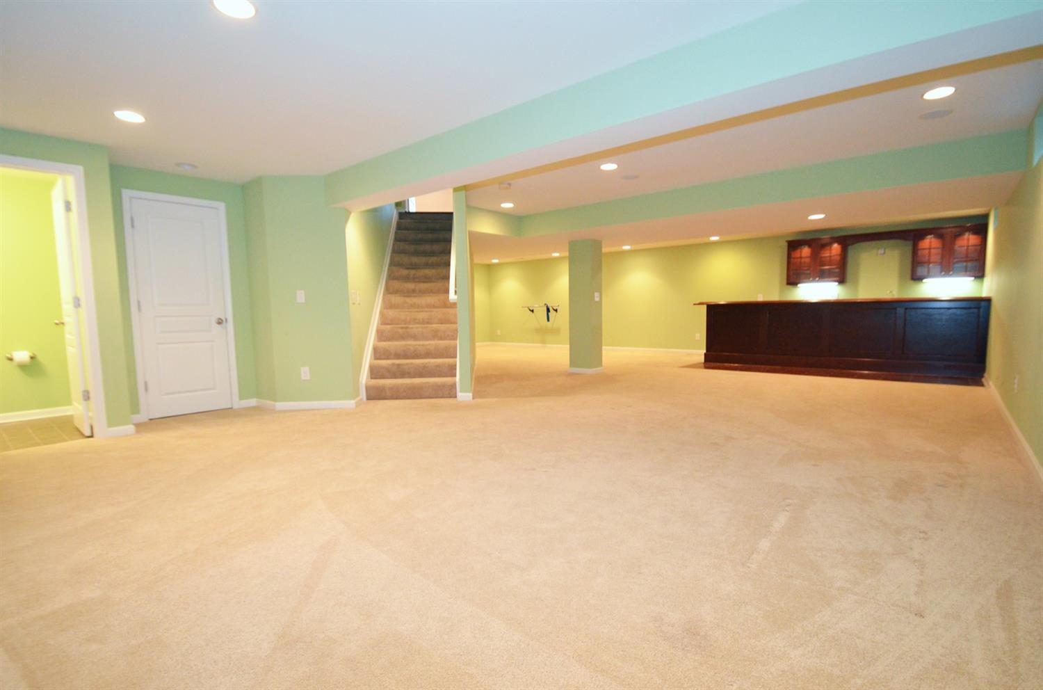 Wow! What a large lower level rec room and game/entertaining space complete the wet bar and half bath. The L-shaped space easily accommodates a media area, bar area and space for games