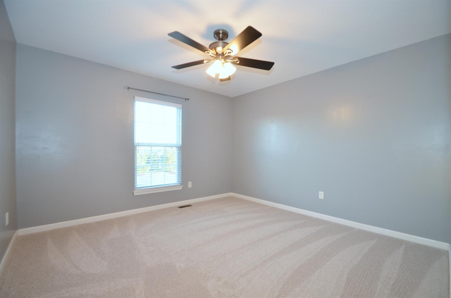 Bedroom 1. Each of the home's four spacious bedrooms feature ceiling fans and walk-in closets!