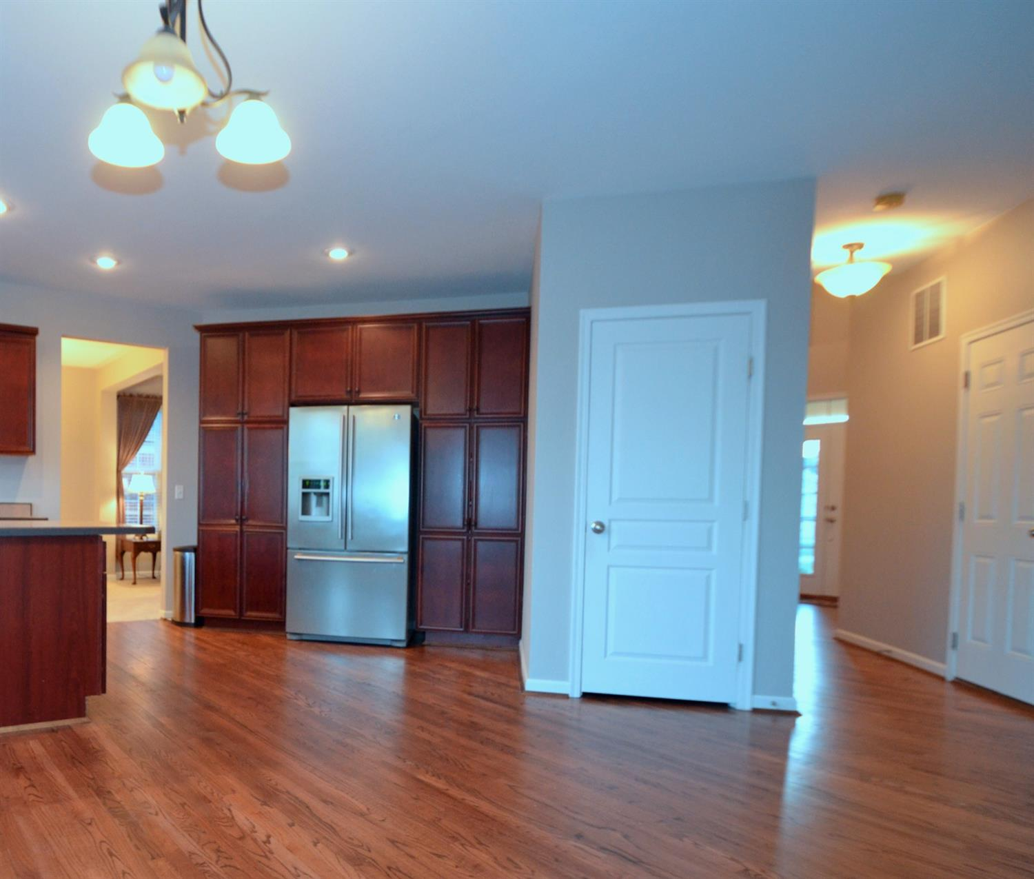 The kitchen is the conveniently located central hub of the home. It flows from the living and dining rooms to a large open family room with ready access to the home's finished lower level, oversized 2-car garage and the front entry.