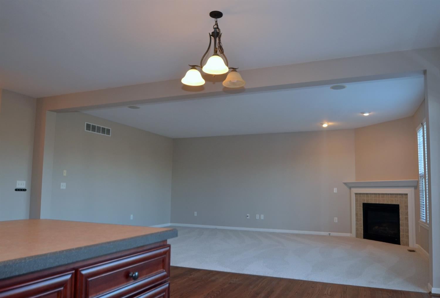 The spacious family room is completely open to the kitchen, eat-in area and walkout to the patio.
