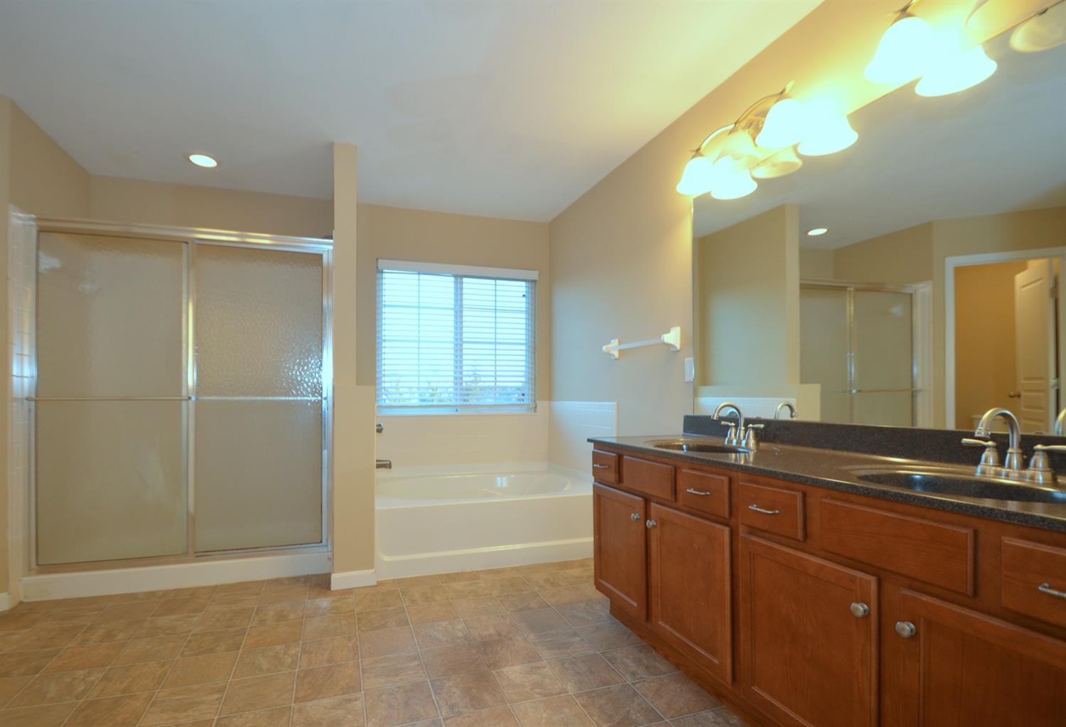 The ensuite master bath feautures a double vanity, oversized soaking tub and separate shower.