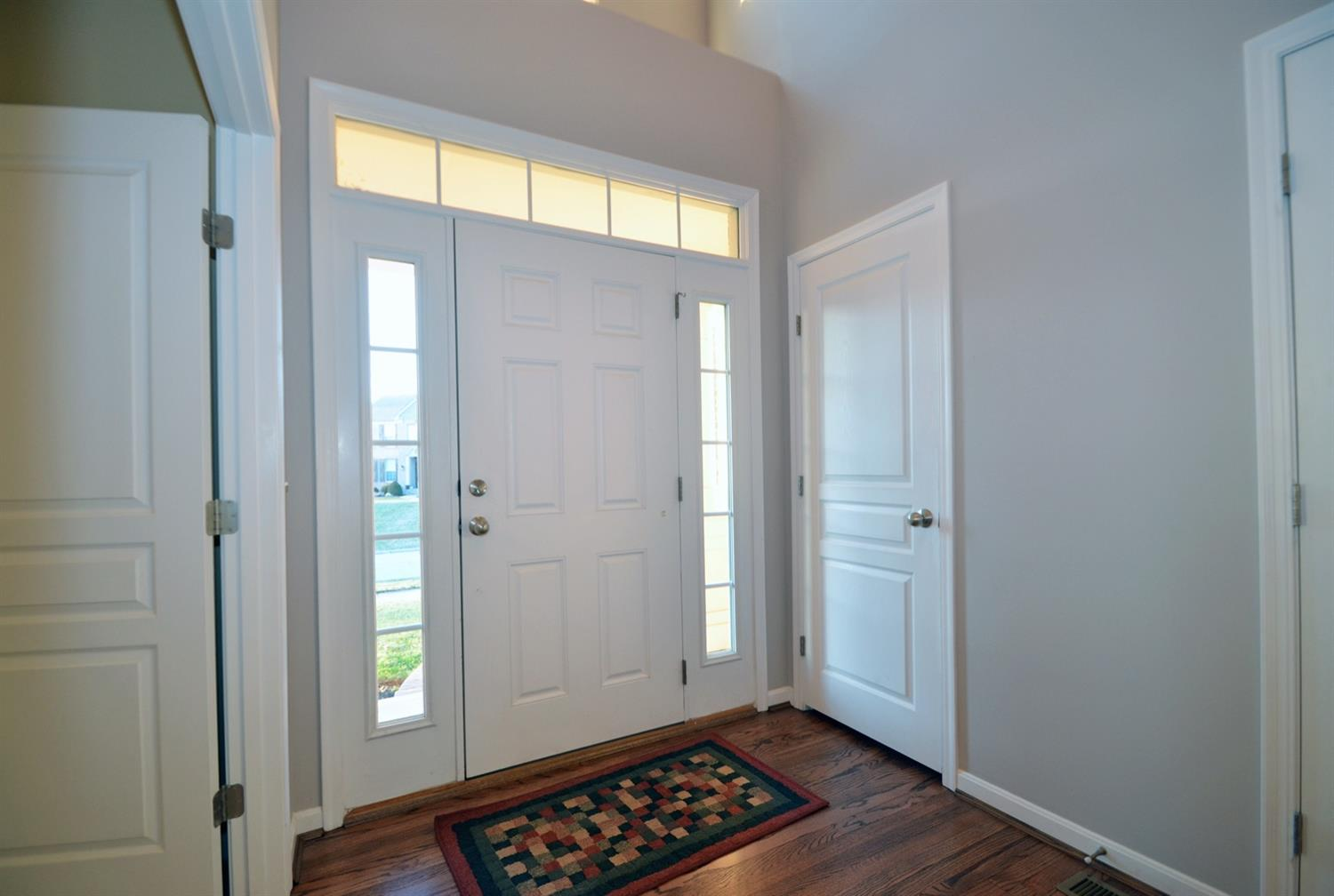 The dramatic and spacious entry features a both a hall closet and a half bath. Additionally the study behind double doors is located directly inside the front door. It's perfect for those working from home or meeting clients.