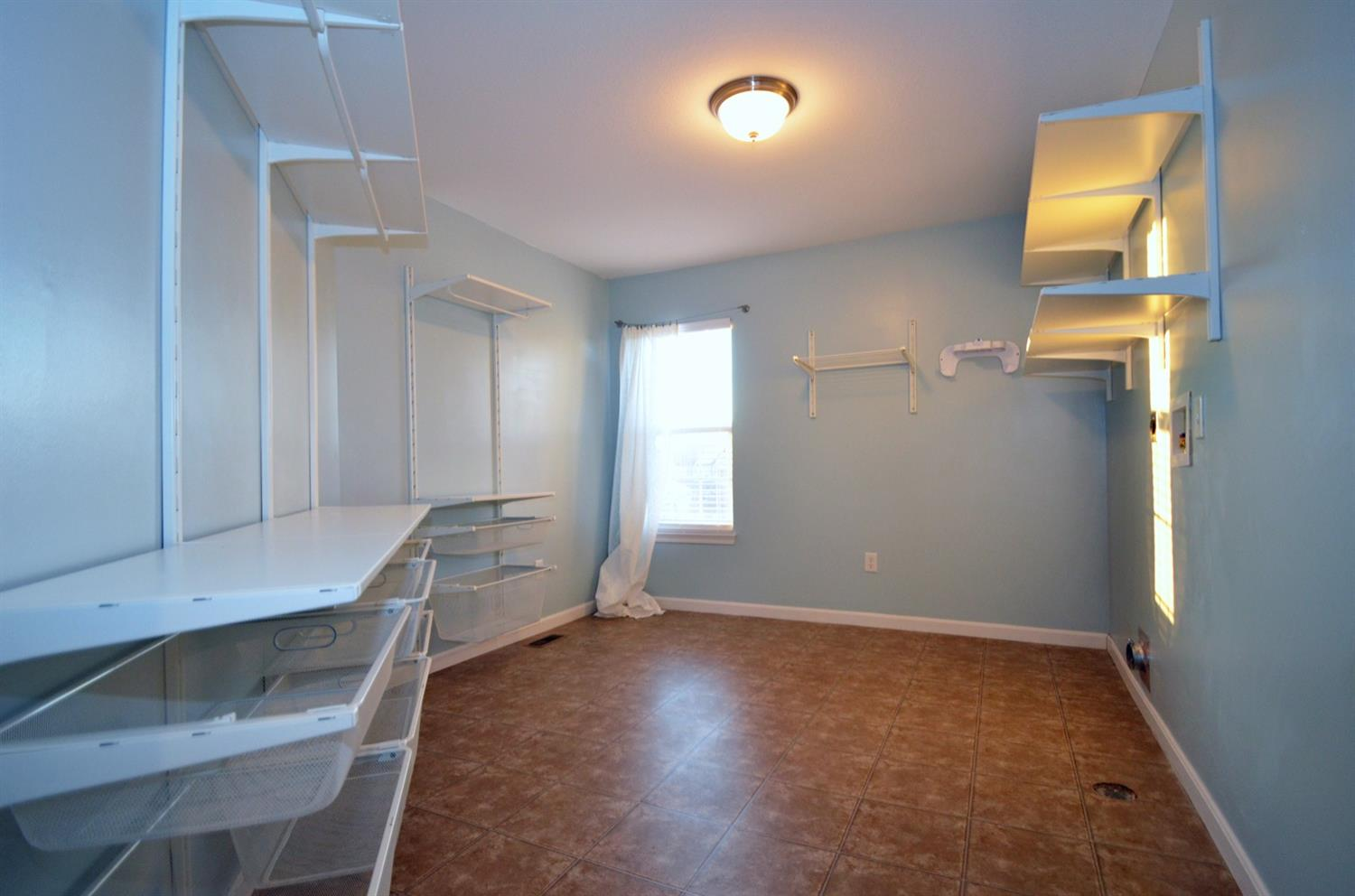 The oversized second floor laundry. Plenty of room for linen storage and importantly, room to fold your clothes!