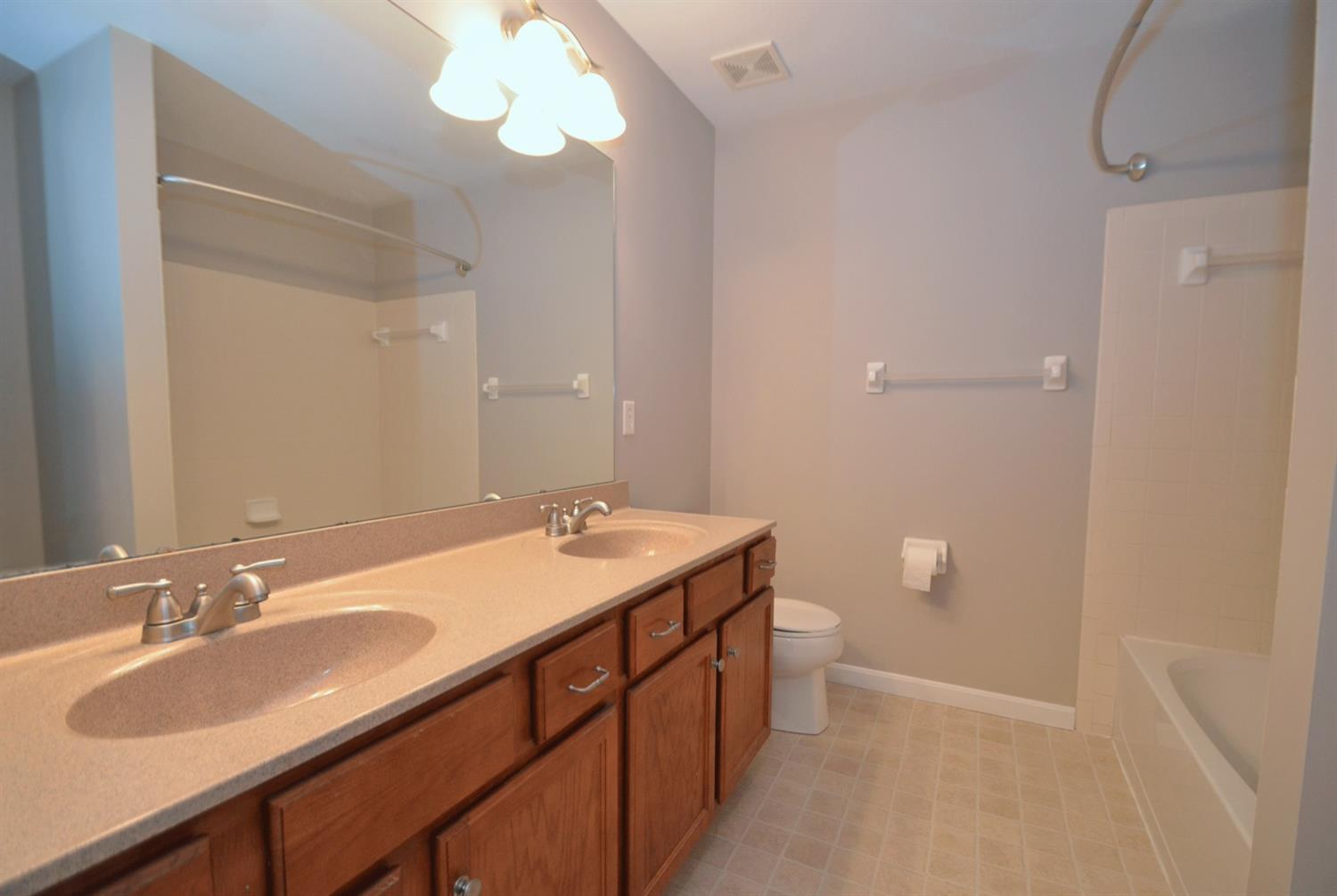 The second floor bath features a large double vanity and a tub/shower.