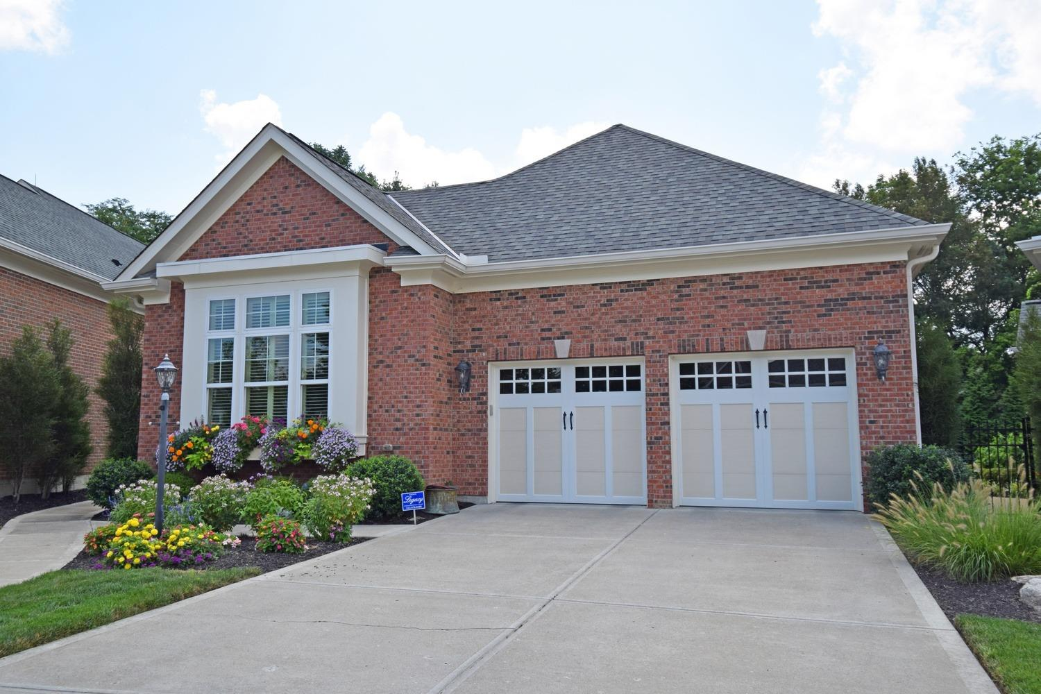 Welcoming front exterior features oversized two car garage and blooming window boxes.