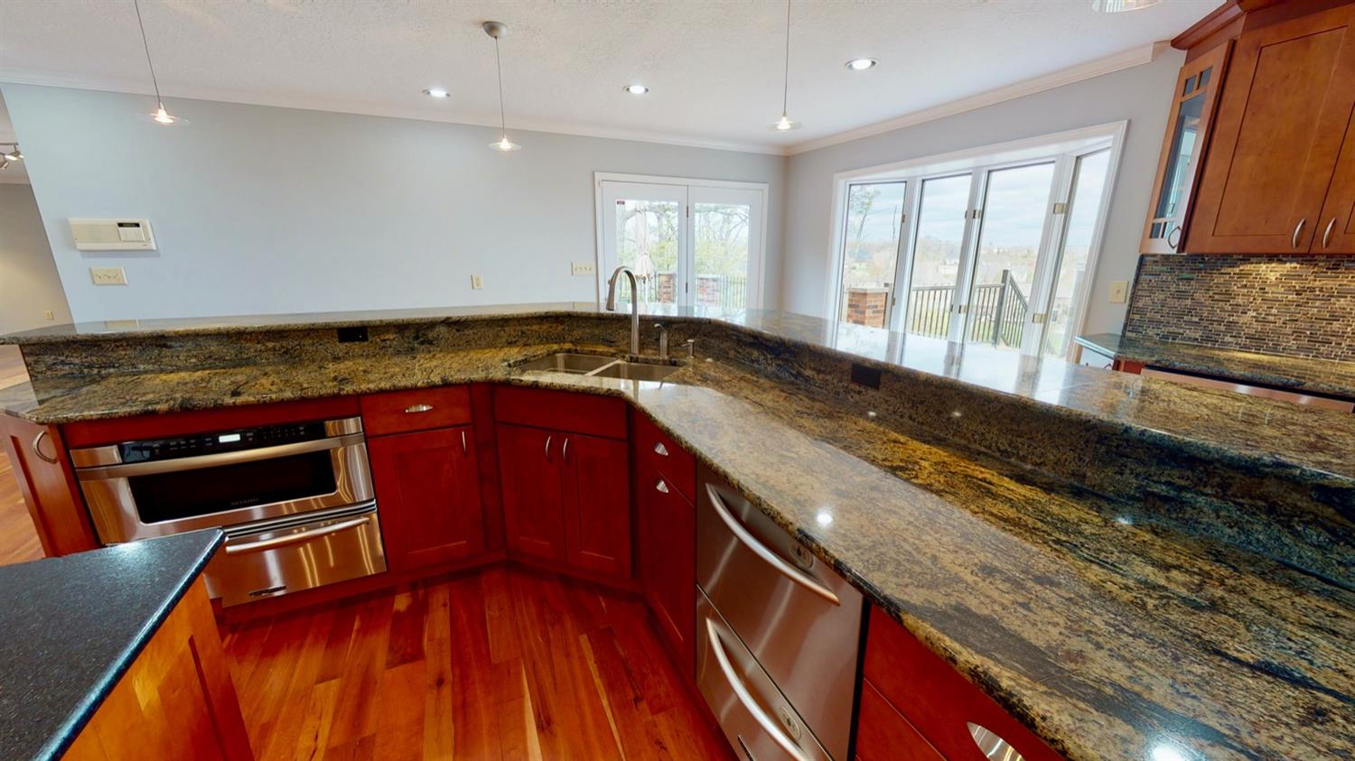 Gourmet kitchen area including microwave drawer oven and double drawer dishwasher.
