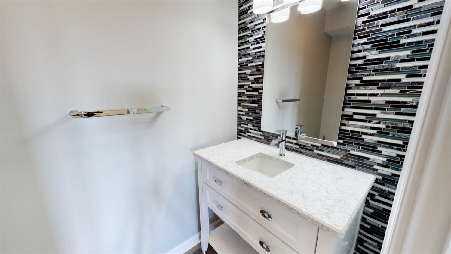 Lower level half bath just off the family room