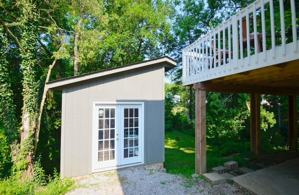 Here it is!  **THE SHED**  Isn't it beautiful?  Currently used for storage, but could be so much more.  She shed?  He shed?  Art studio?  You be the judge.  Larger than it looks from the front.