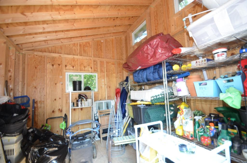 Here is the inside.  It still smells brand new!  And check out the clerestory windows!  It's a MOD SHED!