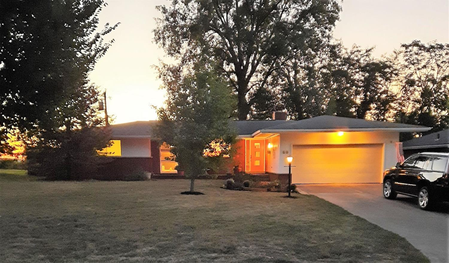 This home is straight from 1959. This gorgeous  Time Capsule has mostly original details including kitchen counters, tiled bathrooms and custom made windows. Beautiful limestone gas fireplace. Tons of closet space and natural light thru-out the entire home. Double closets in each bedrm. Sits on a low traffic Cul de Sac surrounded by mature trees.