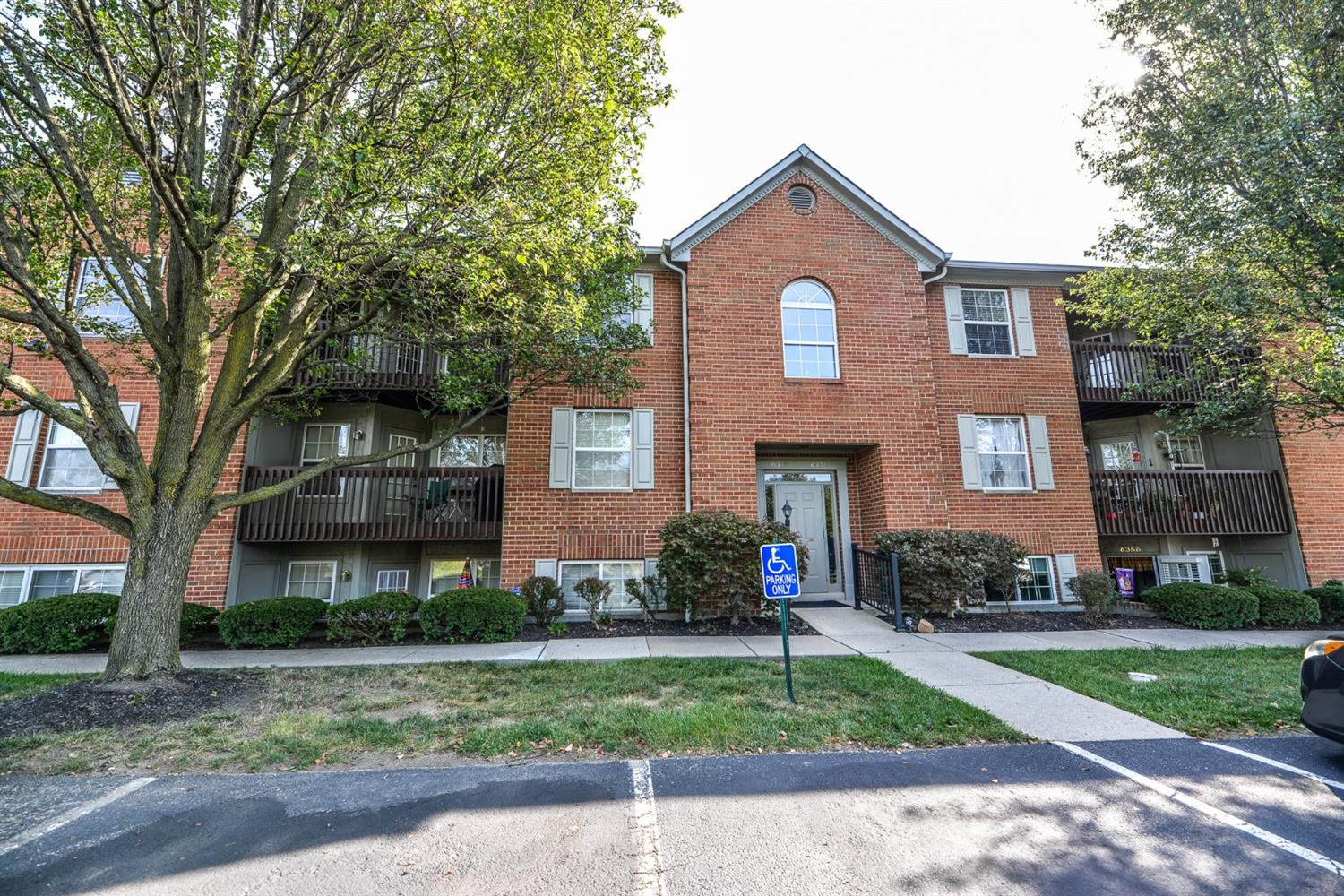 Truly move-in ready condo with features you normally don't see for the price! Updated kitchen w/solid surface counters, tile floor, soft close drawers, wine cooler. All appliances stay. Master w/in closet w/Cali Closet shelving. 2nd BR full bath adjoins. New carpet '20, HVAC'14, Wtr Htr'13. No steps possible using rear entrance. Detached garage.