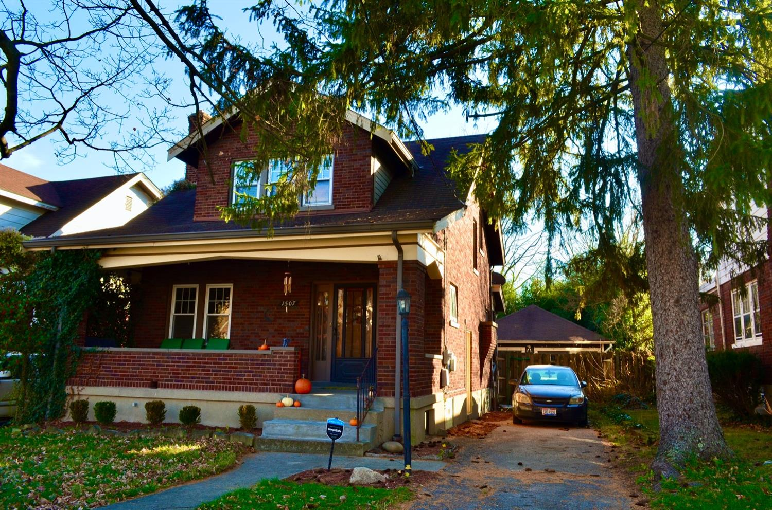 Cincinnati is rich with Craftsman Bungalow homes and this one is not only loaded with detail, but is full brick construction with cool little details - like the band board above the front porch.
