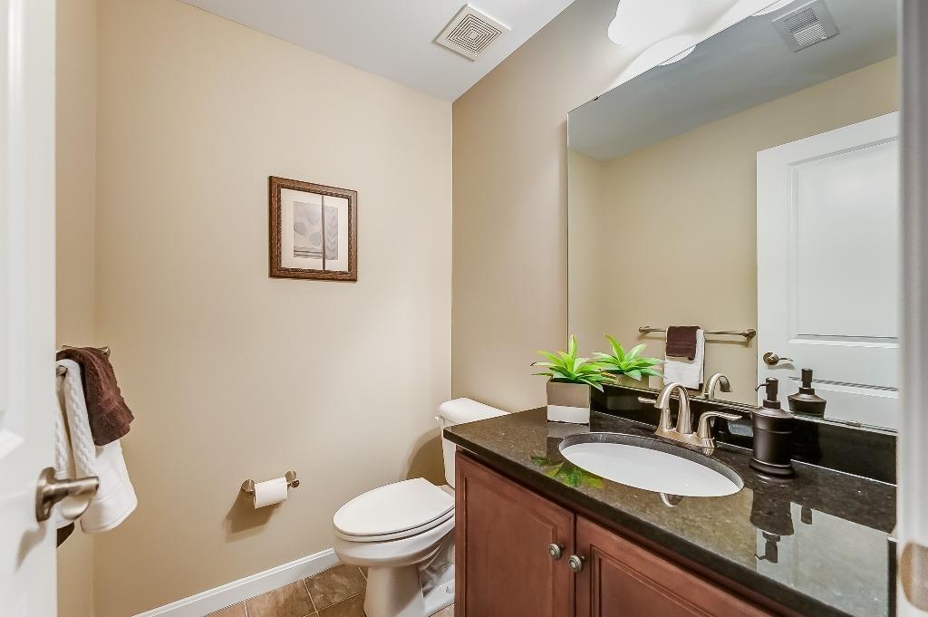Half bath in lower level also has granite countertop