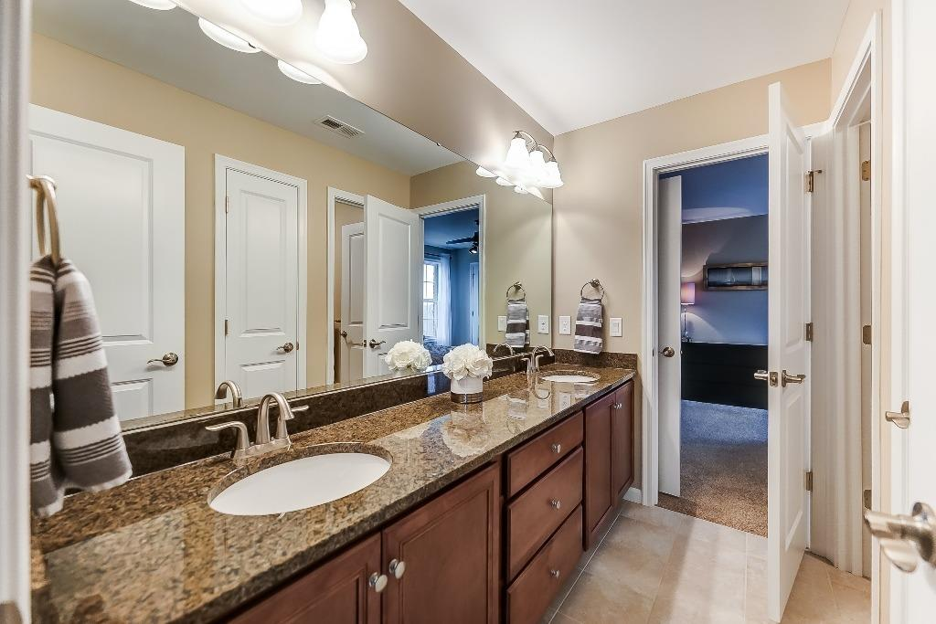 Jack and Jill bath connects bedrooms 3 & 4; double vanities and granite countertop!
