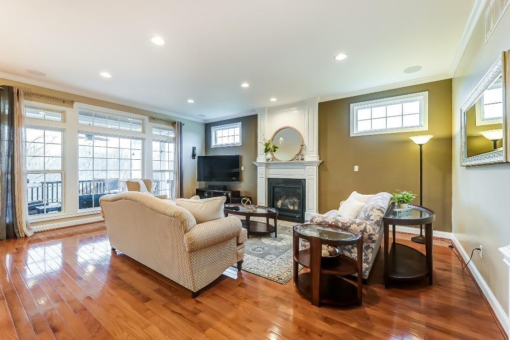 Family room with gas fireplace and wall of windows