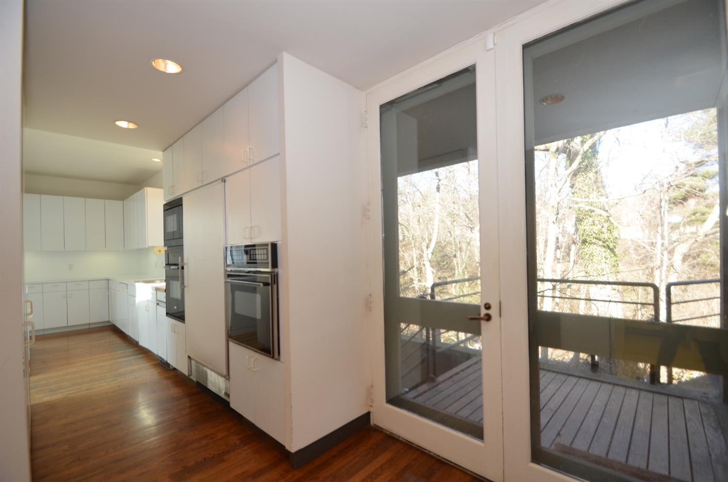 The extended kitchen adjoins the home's service entry.