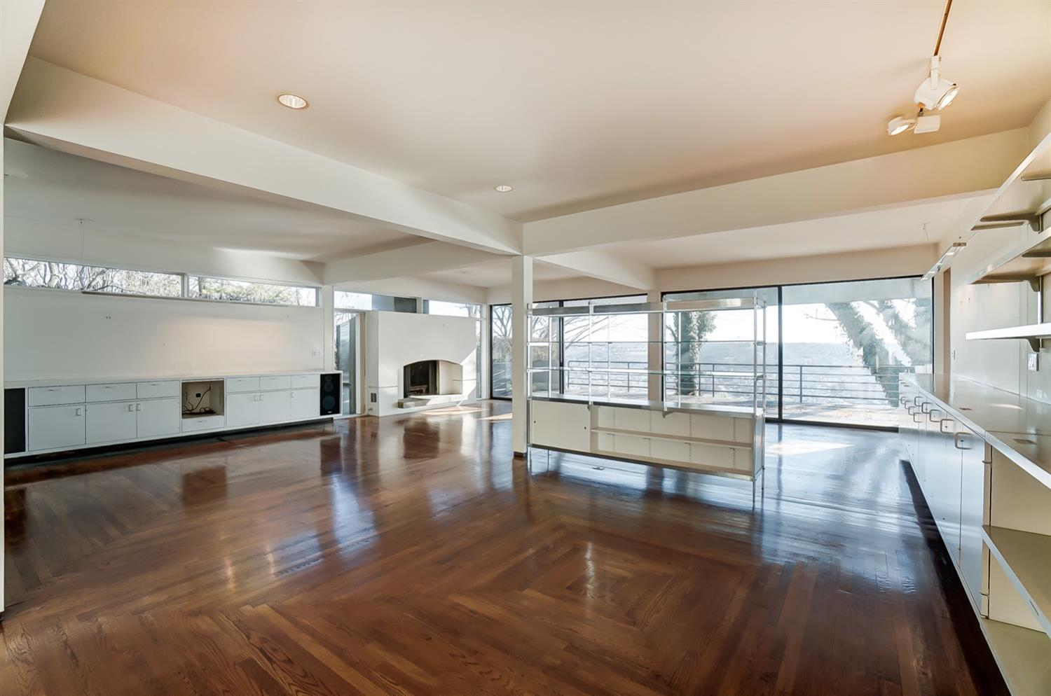 Expansive multi-purpose living area. Original plans note areas as music, living and game.