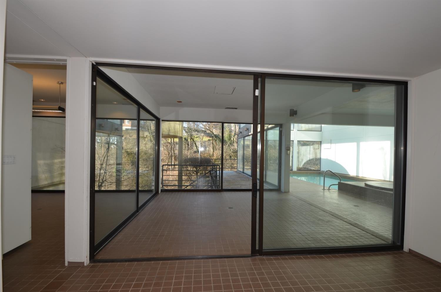 The lower level pool entry area opens to an outdoor deck and provides space to eating and entertaining poolside.