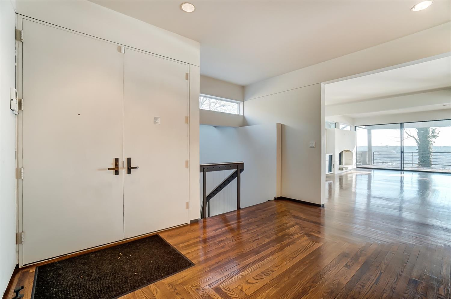 Open spacious entry and stair.