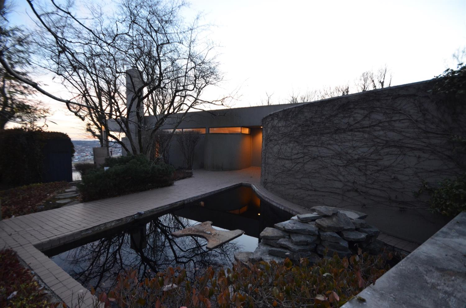 Twilight entry courtyard view.