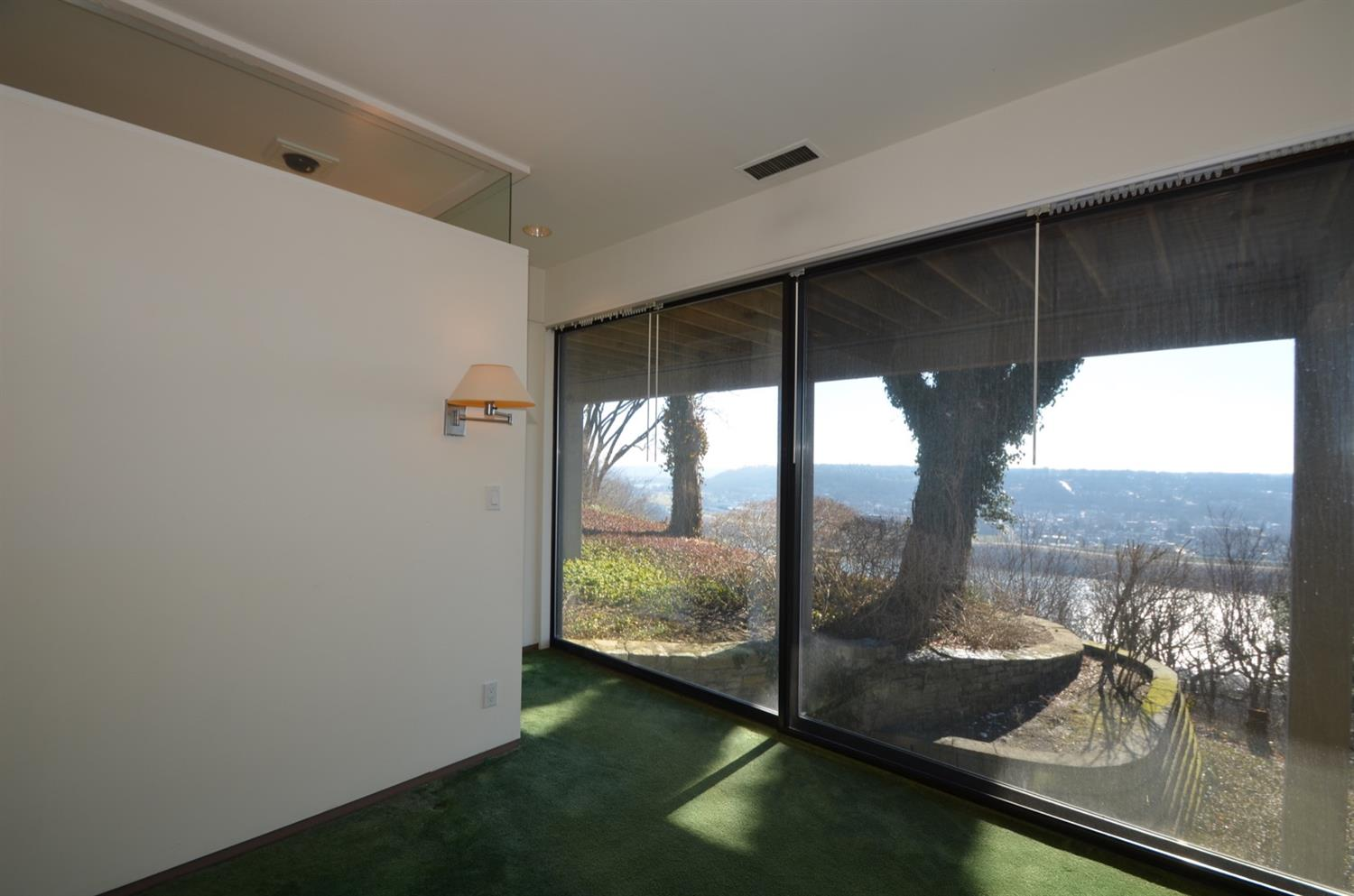 Bedroom 3 also features more custom closet cabinetry and oversized window/sliders overlooking the river view.