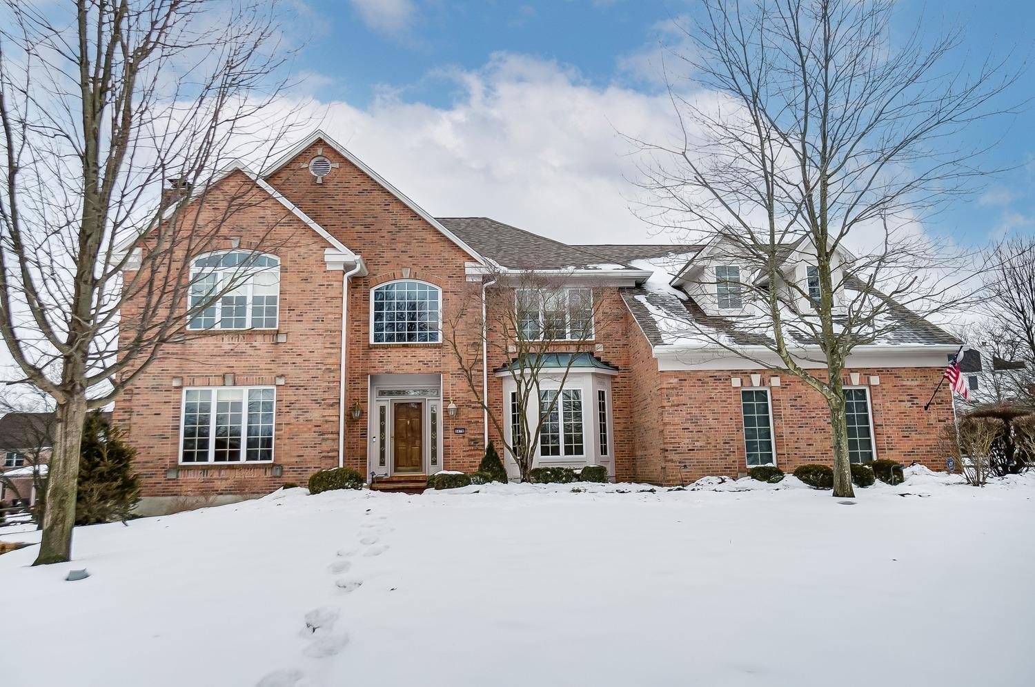 This GRAND home in Beckett Ridge has over 4500 finished sq feet with a finisher LL w/ walkout and an elevator (access to all 3 floors). Tall ceilings, new carpet, fresh paint, white trim, 3 season rm, 3 car garage w/custom workshop...this home has it all! Tons of room to entertain-this can be your forever home. Accepting all offers thru Sunday 5pm.  Seller res rt to accept anytime once home is active. See 3D Tour