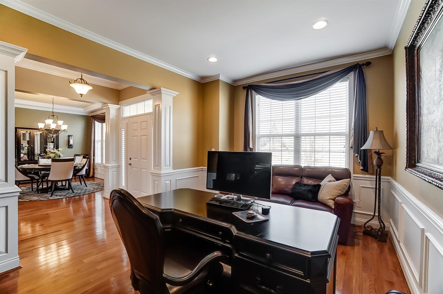 Extensive trim work throughout: crown molding, wainscoting and chair rails through entry, formal dining and study.