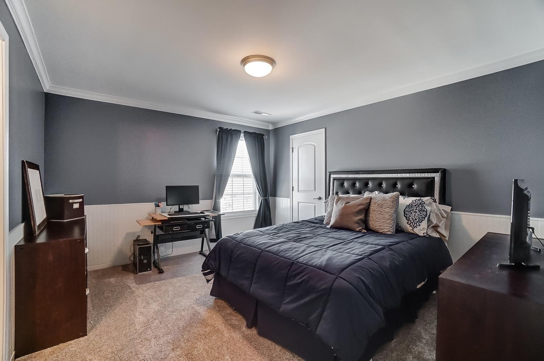 Bedroom 2 has crown molding, beadboard and walk-in closet.