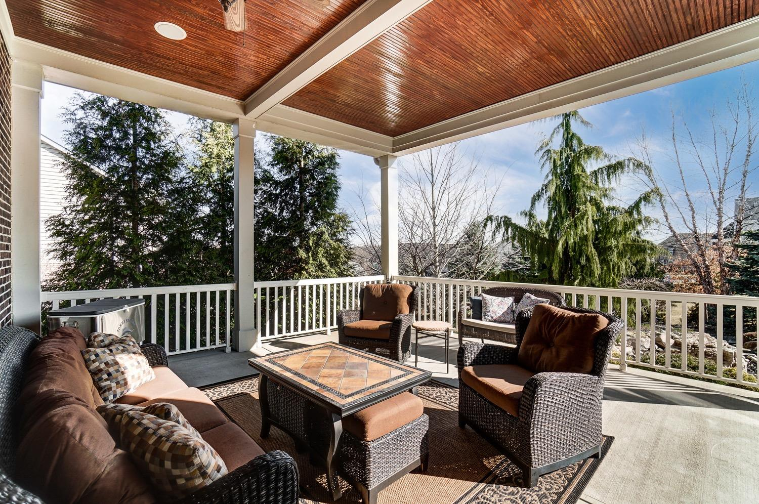 Covered patio w/ ceiling fan and speakers.