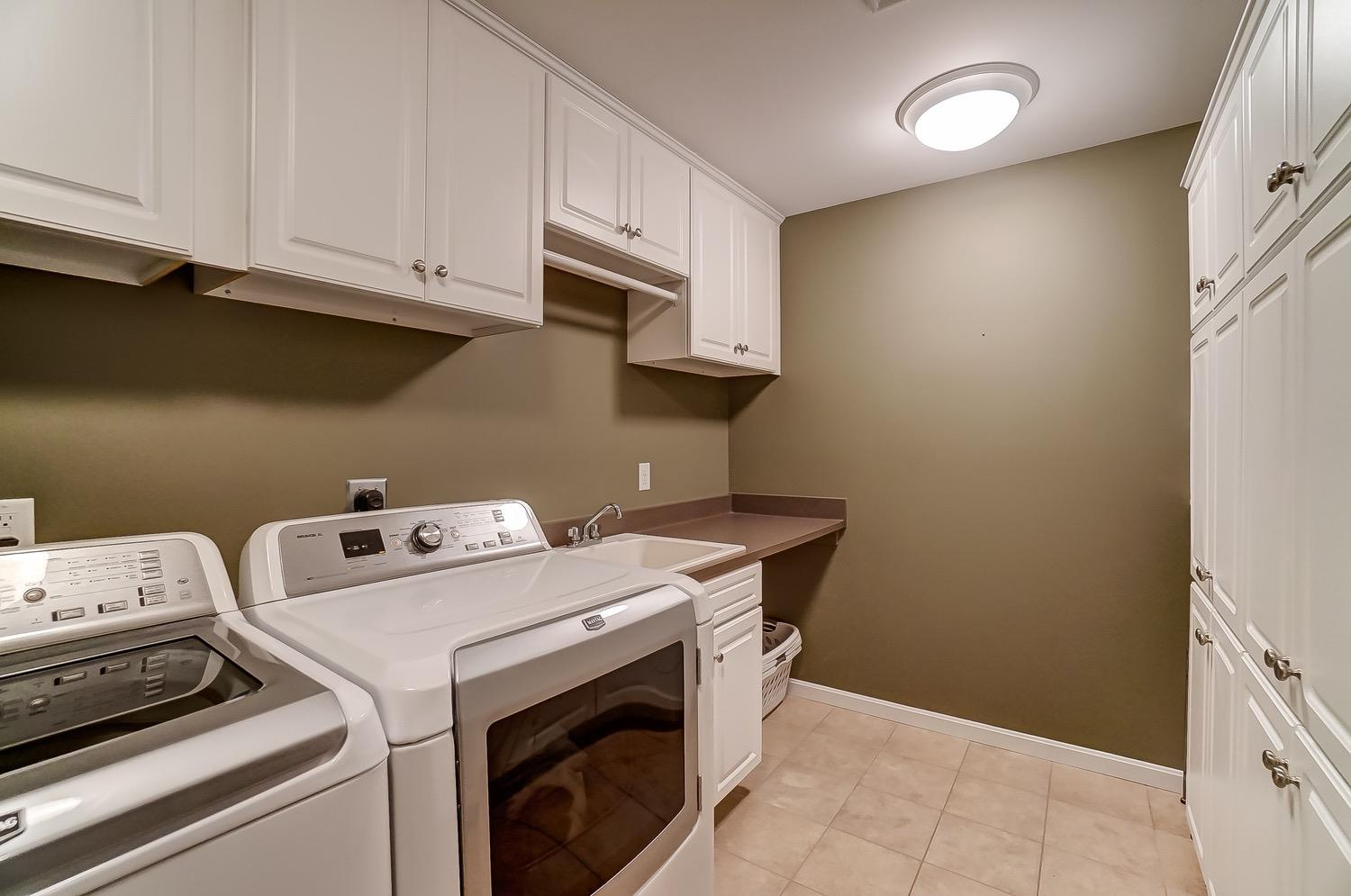 2nd floor laundry room with lots of storage!