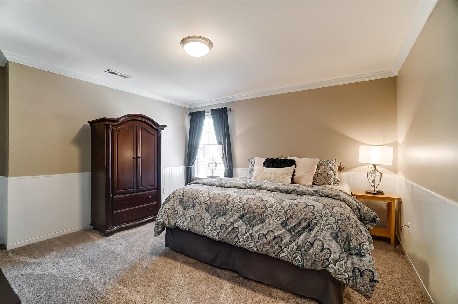Bedroom 3 also features crown molding, beadboard and walk-in closet.