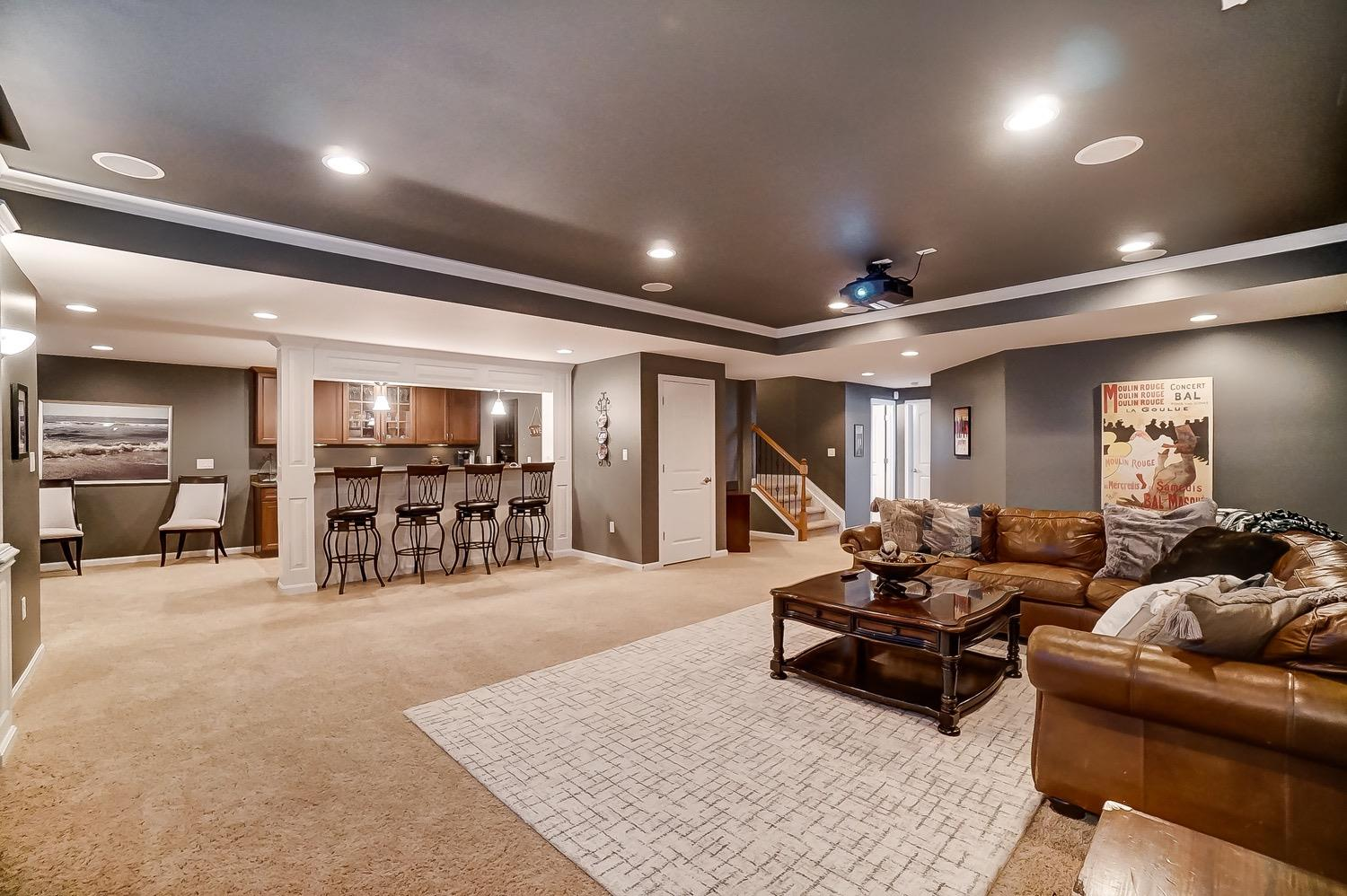 Surround sound speakers in ceiling in theater area.