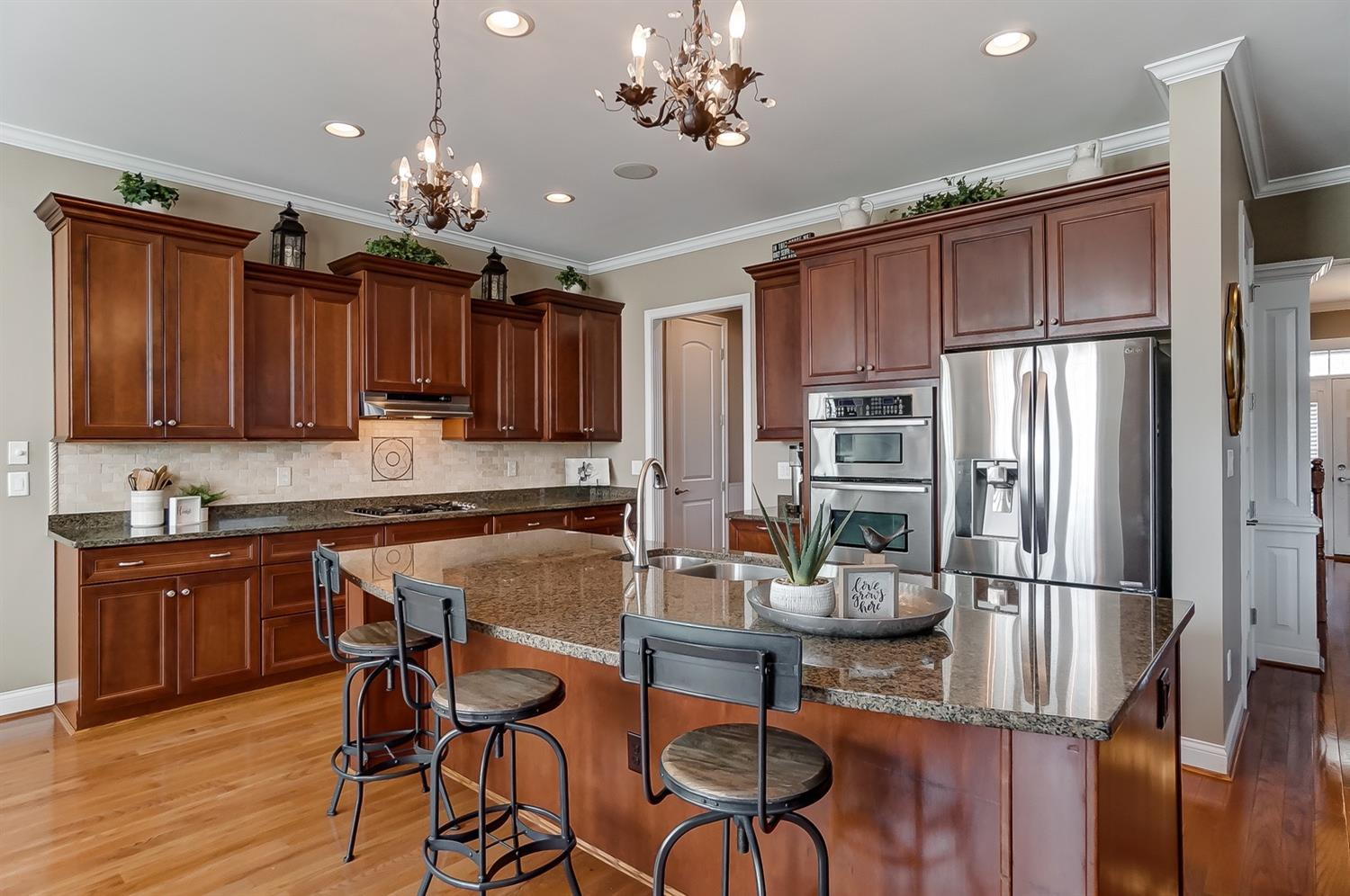 Gourmet kitchen with granite countertops; SS appliances and hardwood floors.