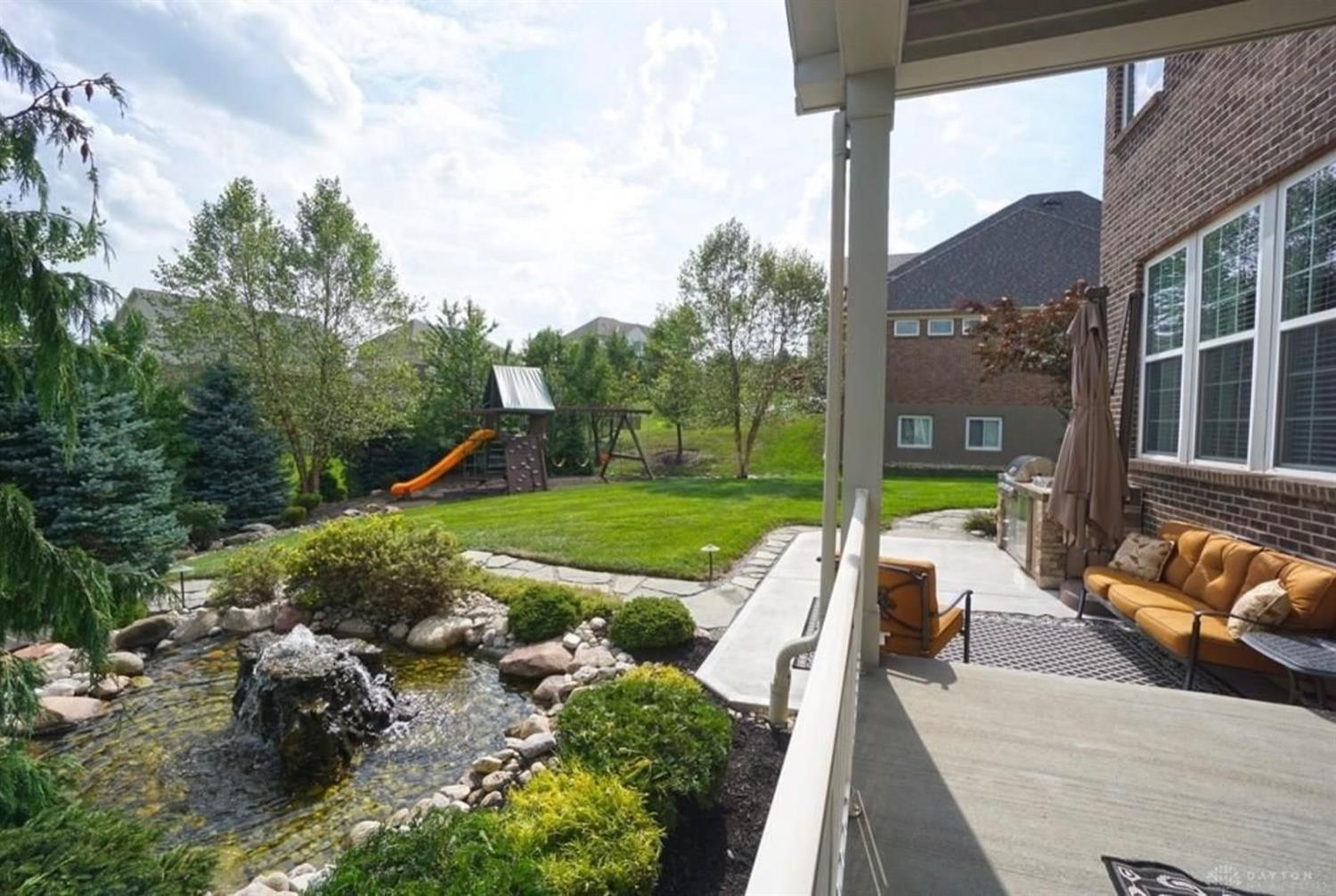 Sit on the covered patio and listen to the peaceful waterfall!