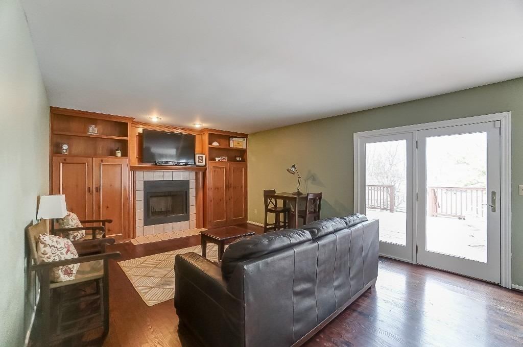 Terrific built-ins with tons of storage. French door walks out to spacious deck. Family room is open to kitchen - great for entertaining.