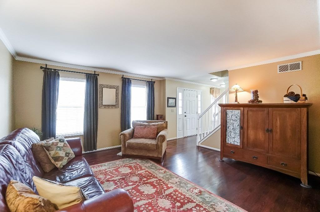 Spacious living room with hardwood floors.