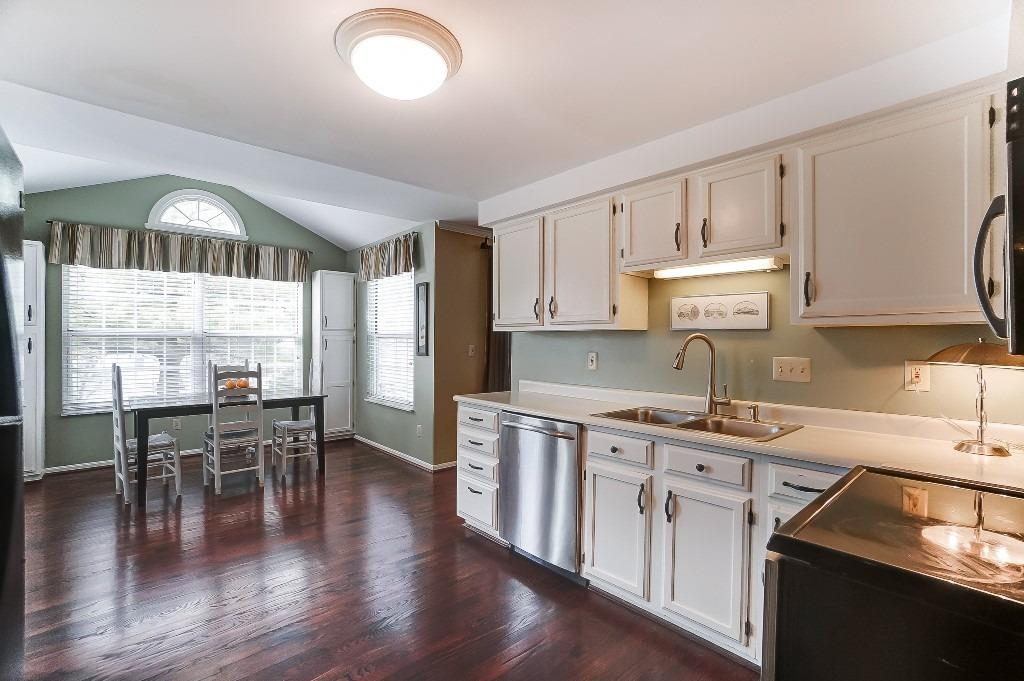 Sunny kitchen with spacious kitchen nook with handy built-in storage.
