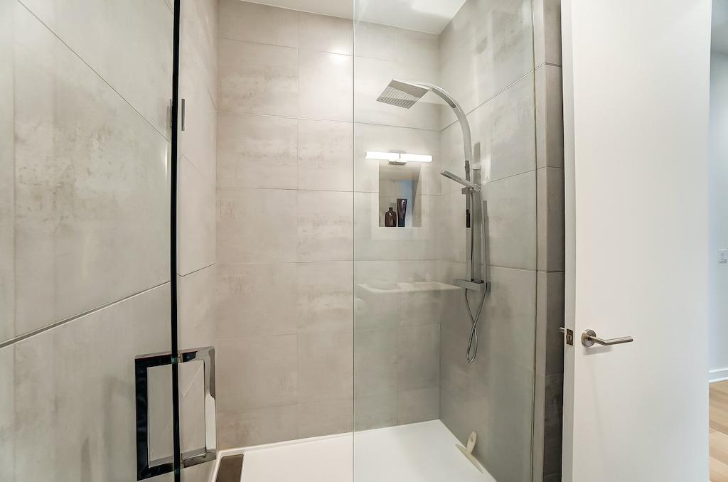 Here is the shower in the hall bath.  The floor to ceiling tile makes all the difference.