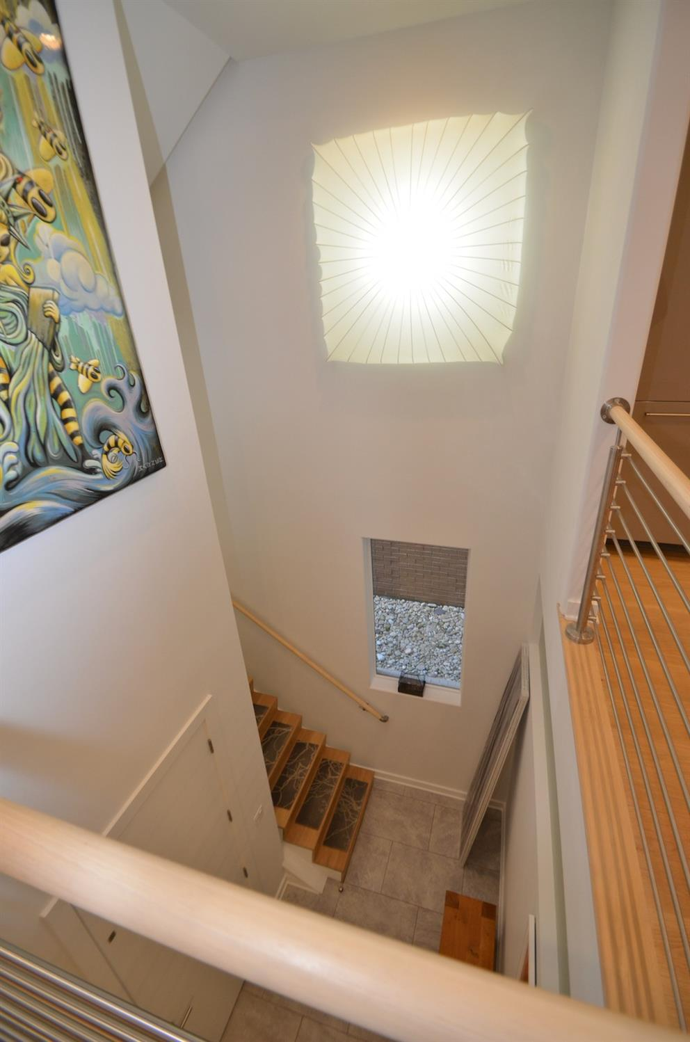 Open - yet secure - stairway is an architecturally significant statement through the core of the home.