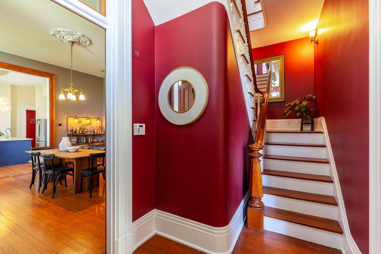 This is the side entry from the patio.  It splits the front living room from the dining and kitchen spaces. The home has been completely updated but has the historic charm and details from its 1880 year built.