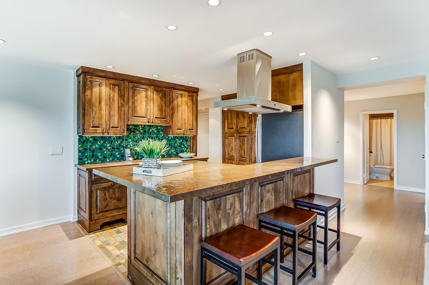 Custom kitchen with counter seating.
