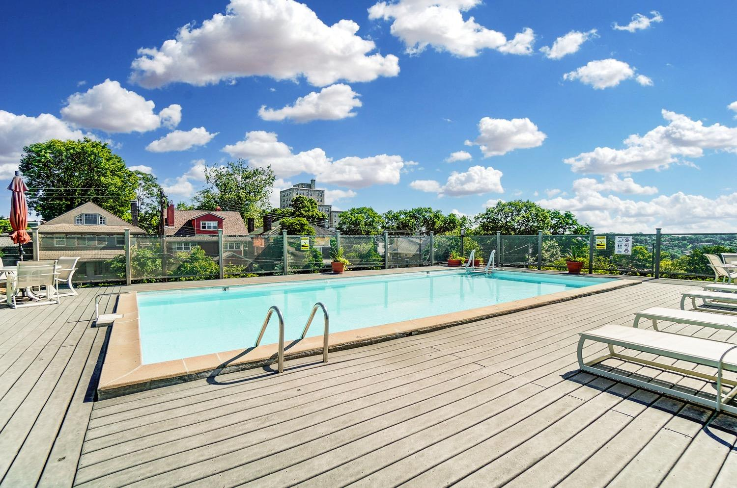 The elevated Husman House outdoor pool with river views from the deck.